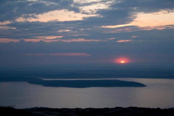 "The first sunrise you can see in North America each day, standing on Cadillac Mountain. ""Light amidst darkness"" is a standard Advent theme. Taken by Greg & Maura Carpinello."